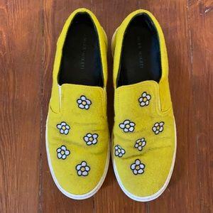 Yellow felt slip-on sneaker with daisy flowers